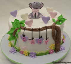 Baby Shower Theme Cake #fondantbabyelephant #fondanthearts #fondantflowersandleaves #babyshowercake #strawberrycake