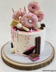 Delicious Goodness All Wrapped In One Cake Donuts , Drips,chocolates ,sprinkles And Cake !!! #donuts #donutanddripcake #whitechocolate #pinkdripcake #sugarshimmer 01