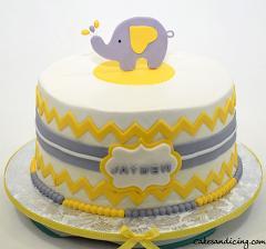 Elephant Theme Baby Shower Cake #babyshowercakes #yellowandgreycake #elephantbabyshowercake #buttervanillacake #chocolateganachefilling #fondantchevron